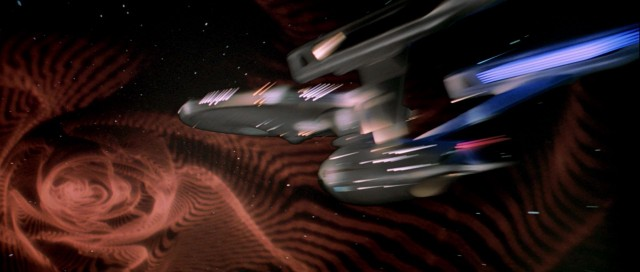 USS_Enterprise_caught_in_artificial_wormhole-640x272