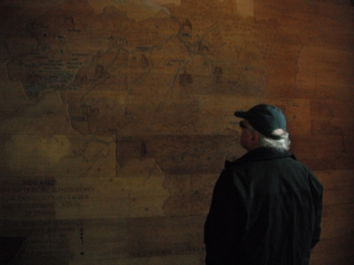 My father examining the map of the Ypres Salient inside the cemetery's entrance foyer
