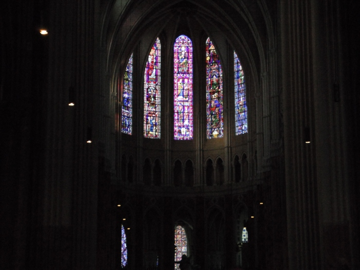 The stained-glass windows located at the nave