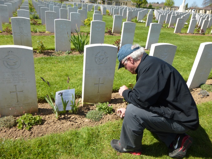 My father placing soil from Bramford by Wilmot's headstone