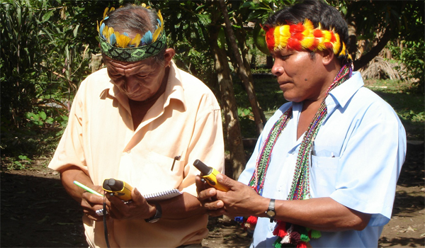 Achuar community monitors learning to use GPS